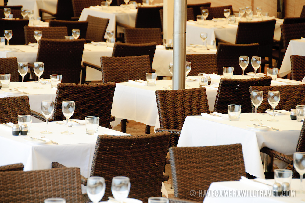 Rows of empty tables in a restaurant in Sydney