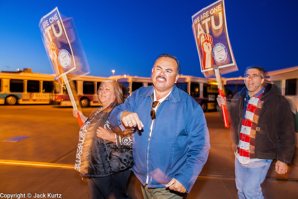 12 MARCH 2012 - PHOENIX, AZ:  RICO RODRIGUEZ, who has been a bus driver for 12 years, and other drivers walk a picket line in front of the Veolia Transportation bus barns in Phoenix, AZ, Monday. Nearly 900 bus drivers from Amalgamated Transit Union Local 1433  are on strike against Veolia Transportation which is contracted to provide bus service for Valley Metro, the bus service that spans the Phoenix metropolitan area. The routes affected by the strike are in Phoenix and the suburbs of Tempe and Glendale. According to the union, the strike was called because of Veolia's conduct during negotiations, which have lasted more than two years. The union has filed Unfair Labor Practices charges against Veolia with The National Labor Relations Board and the NLRB is taking Veolia before an Administrative Law Judge on April 3, 2012 to answer the charges.       PHOTO BY JACK KURTZ