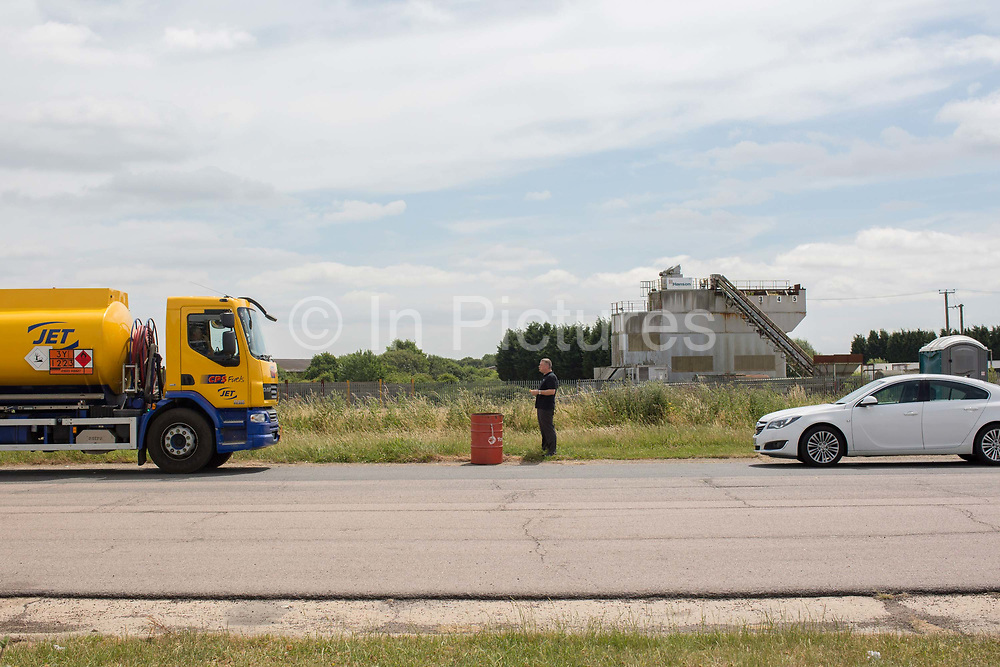 A lorry driver finishes his lunch at a roadside burger van on the 23rd June 2017 in Brome North Suffolk, United Kingdom. The burger van has changed hands a few times over the years, and is conveniently set up in the busy grounds of the Roy Humphrey's industrial estate, in Suffolk's agricultural heartland. The snack bar serves both workers and passing traffic from the busy A140.