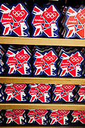 London 2012 Olympic Games merchandise on sale in a supermarket. Biscuit tins decorated in the Olympics logo and coloured in the red white and blue of the Union Jack flag.