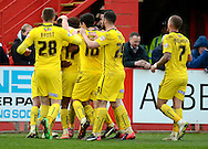 Plymouth players celebrate the third goal during the Sky Bet League 2 match between Cheltenham Town and Plymouth Argyle at Whaddon Road, Cheltenham, England on 28 March 2015. Photo by Alan Franklin.