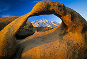 Granite arch in California's Alabama Hills with the Sierra Nevada range in the distance