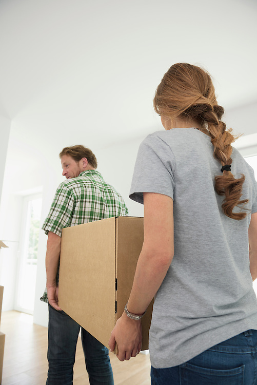 Carrying boxes moving in couple house