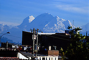 From Huaraz, see the extinct volcano of Huascaran (22,205 feet), highest peak in Peru, rising within Huascaran National Park, in the Cordillera Blanca, Andes Mountains, South America. UNESCO honored Huascaran National Park on the World Heritage List in 1985. The Cordillera Blanca mountain range is in the Sierra Central of the Peruvian Andes.