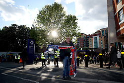 A scarf seller outside the ground before the Premier League match at Stamford Bridge, London.