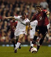 Photo. Jed Wee.<br /> Manchester United v Dinamo Bucharest, UEFA Champions League Qualifying 2nd Leg, 24/08/2004.<br /> Manchester United's Christiano Ronaldo (R) takes on Dinamo's Cristi Irimia