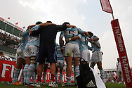 Action from the 2008-2009 opening event in the IRB World sevens series, the Emirates Airline Dubai Sevens 2008 tournament at the new Sevens Stadium in Dubai on 28th/29th November 2008. Argentina players leave the field after playing against England.