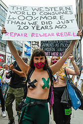 "© Licensed to London News Pictures. 09/09/2020. LONDON, UK.  Activists from Extinction Rebellion (XR) stage a ""Guerilla Repair"" pop-up outside the H&M store on Oxford Street to protest against the environmental and human effects of fast fashion and disposable fashion.  Photo credit: Stephen Chung/LNP"