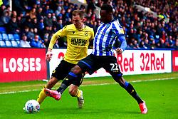 Moses Odubajo of Sheffield Wednesday puts pressure on Jed Wallace of Millwall - Mandatory by-line: Ryan Crockett/JMP - 01/02/2020 - FOOTBALL - Hillsborough - Sheffield, England - Sheffield Wednesday v Millwall - Sky Bet Championship