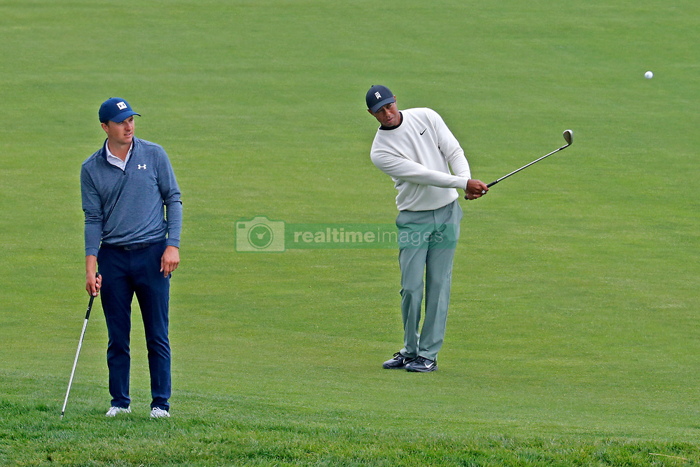 June 12, 2019 - Pebble Beach, CA, U.S. - PEBBLE BEACH, CA - JUNE 12: PGA golfer Jordan Spieth and Tiger Woods play the 18th hole during a practice round for the 2019 US Open on June 12, 2019, at Pebble Beach Golf Links in Pebble Beach, CA. (Photo by Brian Spurlock/Icon Sportswire) (Credit Image: © Brian Spurlock/Icon SMI via ZUMA Press)