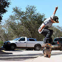 Ryan Nakatewa, 16, plays on his skateboard on a back road in Pueblo of Zuni Saturday