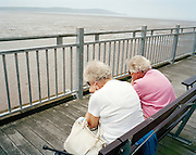 Seaside spectators await fly-past by the 'Red Arrows', Britain's Royal Air Force aerobatic team at Weston-super-Mare