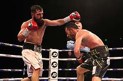 Jono Carroll (left) and Guillaume Frenois in action during the Final Eliminator for IBF Super-Featherweight Champioship match at the FlyDSA Arena, Sheffield.