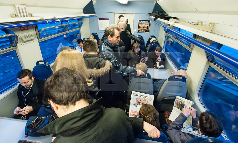 © Licensed to London News Pictures. 30/01/2015. London, UK. Commuters suffer severely overcrowded conditions aboard a Thameslink cross London service during Friday morning rush hour, travelling into Central London.  Thames link are running a reduced carriage service as a result of flooding between Farringdon and St Pancras International due to a burst water main. Photo credit : Richard Isaac/LNP