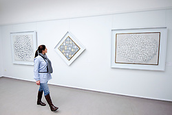 Woman looking at paintings by Piet Mondriaan at Kroller-Muller Museum in The Netherlands