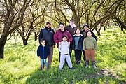 Rosana, Herbert, Benina, Juliana, Ward, Mariana, Rosie, Ward in the almond orchard