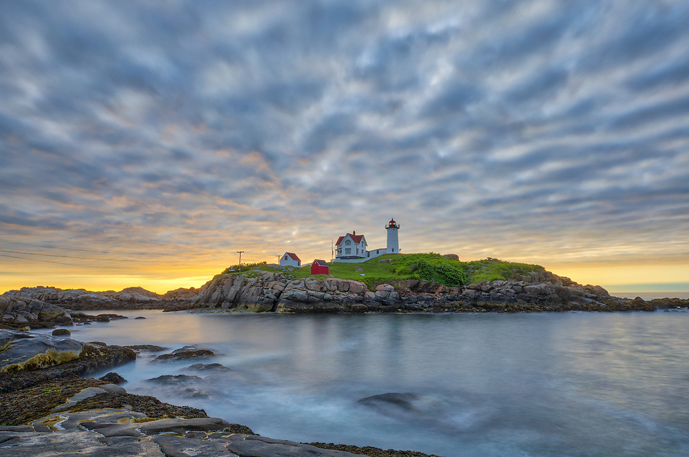 Nuble Lighthouse captured at sunrise in York, ME. Loved viewing this Maine sunrise and capturing the first light at one of New England's most scenic lighthouses, Cape Neddick Lighthouse.<br /> <br /> Maine Nubble Lighthouse fine art photography is available as museum quality photography prints, canvas prints, acrylic prints or metal prints. Prints may be framed and matted to the individual liking and room decor needs:<br /> <br /> https://juergen-roth.pixels.com/featured/nubble-lighthouse-juergen-roth.html<br /> <br /> My best,<br /> <br /> Juergen<br /> Prints: http://www.rothgalleries.com<br /> Photo Blog: http://whereintheworldisjuergen.blogspot.com<br /> Instagram: https://www.instagram.com/rothgalleries<br /> Twitter: https://twitter.com/naturefineart<br /> Facebook: https://www.facebook.com/naturefineart