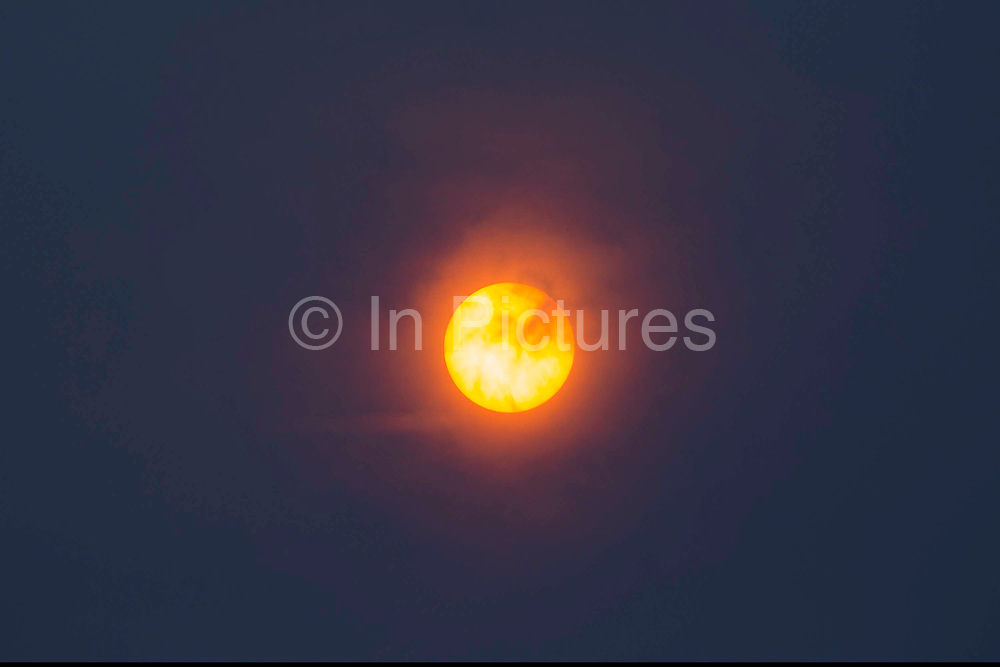A Sahara sun made red by the remains of hurricane Ophelia with dust brought up from the Sahara desert in the skies above Folkestone, Kent.17th October 2017