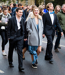 © Licensed to London News Pictures. 01/05/2017. Oxford, UK. Oxford University students make their way home after celebrating May Day in the early hours of the morning near Magdalen Bridge in Oxford, Oxfordshire. Students were again prevented from jumping from the bridge in tot he water, which has historically been a tradition, due to injuries at a previous years event . Photo credit: Ben Cawthra/LNP