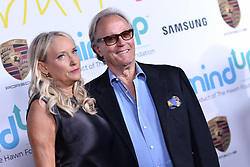 File photo - Margaret Devogelaere, Peter Fonda attend Goldie's Love In For Kids at Ron Burkle's Green Acres Estate on November 3, 2017 in Beverly Hills, Los Angeles, CA, USA. Peter Fonda, the star, co-writer and producer of the 1969 cult classic Easy Rider, has died at the age of 79. Peter Fonda was part of a veteran Hollywood family. As well as being the brother of Jane Fonda, he was also the son of actor Henry Fonda, and father to Bridget, also an actor. Photo by Lionel Hahn/ABACAPRESS.COM