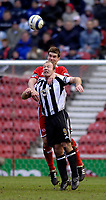 Photo: Jed Wee.<br /> Middlesbrough v Newcastle United. The Barclays Premiership. 09/04/2006.<br /> <br /> Middlesbrough's Chris Riggott climbs above Newcastle's Alan Shearer to win the ball.