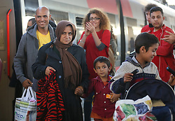 © London News Pictures. 06/09/2015. A migrant family get off a train at Wien Westbahnhof train station, Vienna, Austria, September 6 2015.  Hundreds of migrants have resumed their journey through Austria to Germany after Hungary's decision on Friday to let them through. Picture by Paul Hackett/LNP