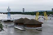 """Vienna, Austria. The Danube reaches its highest level since the heavy flooding in 2002.<br /> Entlastungsgerinne (flood relief channel) with the flooded restaurants and bridges at """"Copa Cagrana"""" seen from Reichsbrücke."""