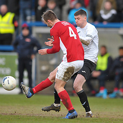 TELFORD COPYRIGHT MIKE SHERIDAN Matt Stenson of Telford (on loan from Solihull Moors) tackles Shane Byrne of Brackley during the Vanarama Conference North fixture between AFC Telford United and Brackley Town at the New Bucks Head on Saturday, January 4, 2020.<br /> <br /> Picture credit: Mike Sheridan/Ultrapress<br /> <br /> MS201920-039