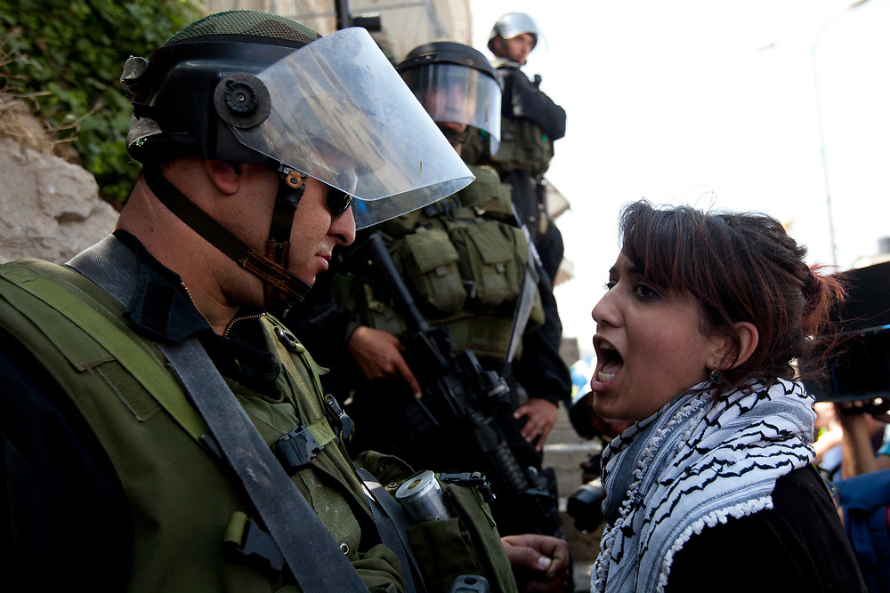 A Palestinian demonstrator (R) shouts at an Israeli soldier, during clashes with Israeli troops at the Qalandiya checkpoint, between Jerusalem and the West Bank city of Ramallah on June 5, 2011. Palestinians Mark The 44th Anniversary of the 1967 Six Day War.