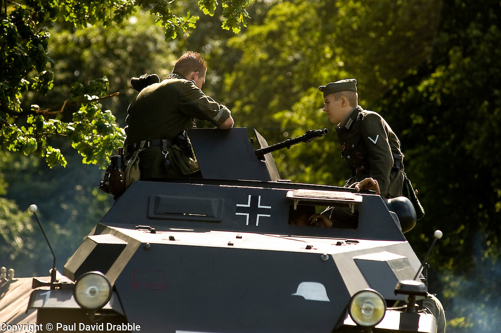Re-enactors portray  members of the German elite heer unit GrossDeutschland Panzer Grenadier Division behind an MG34 mounted on a SdkFz 251 Auf C Halftrack at a multiperiod event held in Norfolk Heritage Park Sheffield 29th and 30th Aug 2010 .Images © Paul David Drabble..