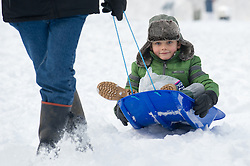 © under license to London News Pictures.  19/12/2010 A child is pulled along in a sledge through the freshly fallen snow in Pershore, Worcestershire, today (19/12/2010). Snow has fallen over much of the UK in the past few days. (Parental permission granted for photograph) Picture credit should read: David Hedges/LNP