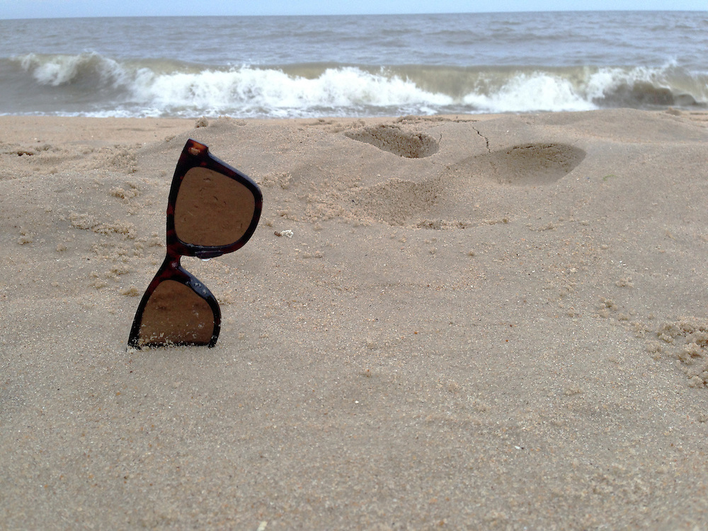 Sunglasses in the sand at the beach in Ocean City, Maryland<br /> Copyright John O'Boyle<br /> john@johnoboyle.com