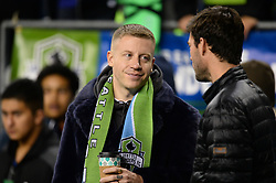 November 30, 2017 - Seattle, Washington, U.S - Soccer 2017: Entertainer MACKLEMOREon the field visiting with Sounder BRAD EVANS on the field before the game as the Houston Dynamo play the Seattle Sounders in the 2nd leg of the MLS Western Conference Finals match at Century Link Field in Seattle, WA. (Credit Image: © Jeff Halstead via ZUMA Wire)