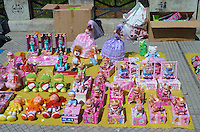 Dolls for sale on the street along Laguna de los Coipos in Buenos Aries. Images taken with a Leica V-Lux 20 camera (ISO 80, 11.9 mm, f/5.6, 1/400 sec)