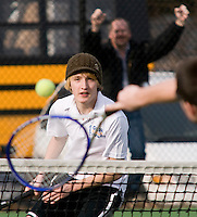Andrew Boardman plays a doubles match for Gilford Boys Tennis during their first home meet against Littleton Friday afternoon at Gilford Village Field.  (Karen Bobotas/for the Laconia Daily Sun)