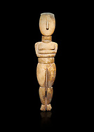 Female Cycladic Canonical type, Spedos variety female figurine statuette. Early Cycladic Period II from Syros phase (2800-2300 BC). Museum of Cycladic Art Athens, cat no 282.  Against black