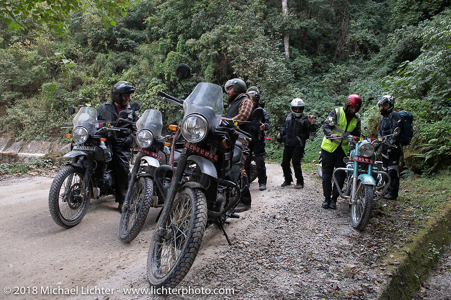 Our group stopped on a windy mountain road to work on Jonathan Pite's bike on day-2 of our Himalayan Heroes adventure riding from Daman to Chitwan, Nepal. Wednesday, November 7, 2018. Photography ©2018 Michael Lichter.
