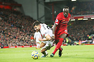 Liverpool forward Sadio Mane (10) battles for possession with Sheffield United defender George Baldock (2) during the Premier League match between Liverpool and Sheffield United at Anfield, Liverpool, England on 2 January 2020.