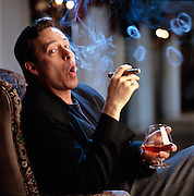 Steven St. James, character actor and voice-over specialist blowing smoke rings.