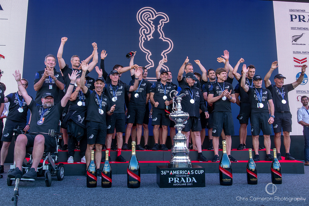 Emirates Team New Zealand on stage being presented with the Americas Cup on stage after beating Luna Rossa Prada Pirelli Team 7 - 3. Glen Ashby pours for Peter Burling.  Wednesday the 17th of March 2021. Copyright photo: Chris Cameron