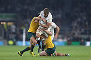 Geoff Parling of England charges into Matt Giteau of Australia and Michael Hooper of Australia. Rugby World Cup 2015 pool A match, England v Australia at Twickenham Stadium in London, England  on Saturday 3rd October 2015.<br /> pic by  John Patrick Fletcher, Andrew Orchard sports photography.