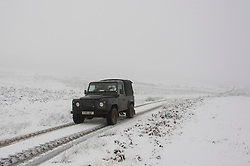 © Licensed to London News Pictures. 28/12/2020. Builth Wells, Powys, Wales, UK. A 4WD vehicle drives through a wintry landscape on the Mynydd Epynt moorland near Builth Wells in Powys, Wales, UK. Photo credit: Graham M. Lawrence/LNP