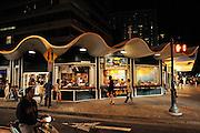 """Cheeseburger In Paradise"" restaurant at night. Waikiki, Honolulu, Hawaii"