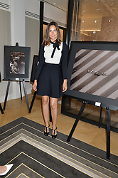 ASTRID MUÑOZ at a private view of photographs by Astrid Munoz entitled Unbridled Synchrony hosted by  Jaeger-LeCoultre at their boutique at 13 Old Bond Street, London on 13th July 2015.