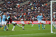 West Ham United defender Angelo Ogbonna (21) clears the ball out of danger during the Premier League match between West Ham United and Manchester City at the London Stadium, London, England on 29 April 2018. Picture by Toyin Oshodi.