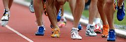 30-06-2007 ATLETIEK: NK OUTDOOR: AMSTERDAM<br /> hardlopen, schoenen, benen item atletiek creative illustratief<br /> ©2007-WWW.FOTOHOOGENDOORN.NL