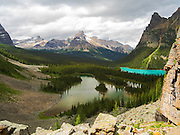 High angle ivew of Mary Lake (foreground), Lake O'Hara (right), Cathedral Peak (background) and Wiwaxy Peak (right); Yoho National Park, Field, British Columbia, Canada
