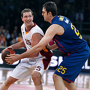 Galatasaray's Darius SONGAILA (L) and  FC Barcelona Regal's Erazem LORBEK (R) during their Euroleague group D matchday 5 Galatasaray between  FC Barcelona Regal at the Abdi Ipekci Arena in Istanbul at Turkey on Thursday, November 17 2011. Photo by TURKPIX