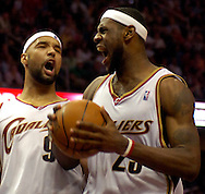 PHOTO BY DAVID RICHARD.Drew Gooden, left, and LeBron James react after James nearly made a tough layup while being fouled yesterday against Washington.