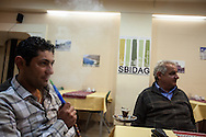 Syrian friends sitting in Sbidag restaurant, recently opened for the newly arrived Syrian community. George and Harout both from Aleppo, Syria.